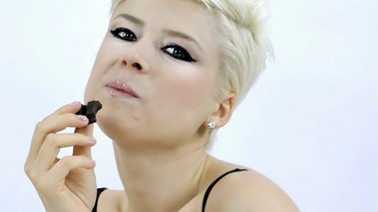 Thumbnail for Beautiful Woman Eats Dhocolate
