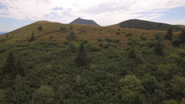 Thumbnail for Aerial travel drone view of the Puy de Dome, lava dome volcano in France.