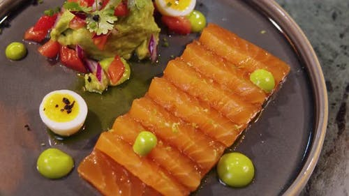 Salmon Raw Sashimi Japanese Traditional Dish on Table