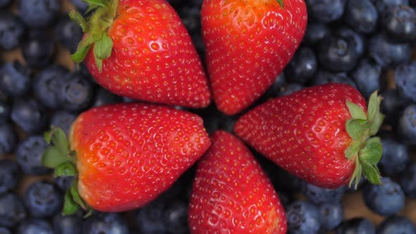 Thumbnail for Close Up Of Strawberries Forming A Circle Laying On Top Of Blueberries Spinning