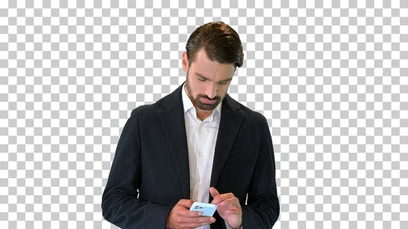 Handsome happy business man texting on smartphone, Alpha Channel