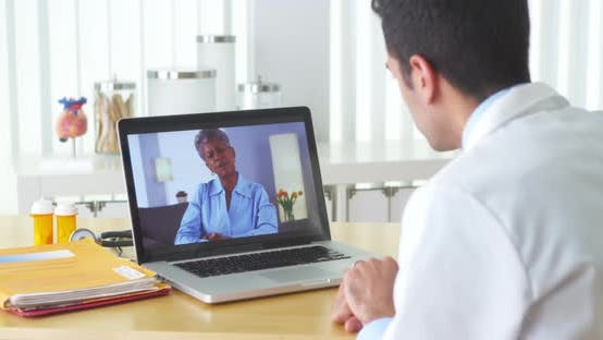 Thumbnail for Mexican doctor video chatting with mature patient