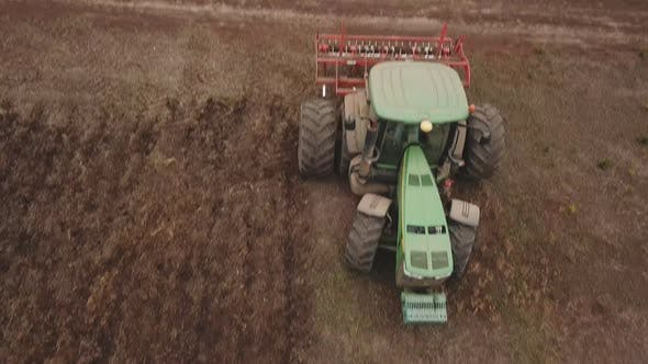 Cover Image for Tractor Plows a Field