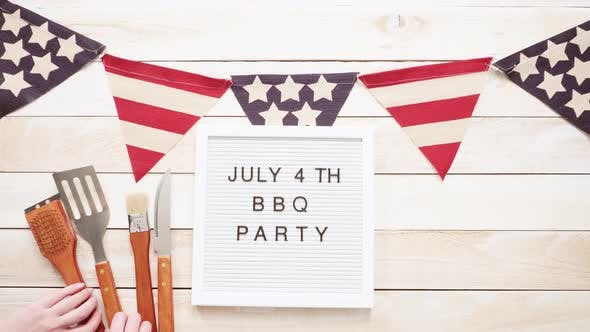 July 4th BBQ Party sign on memo board with July 4th decorations