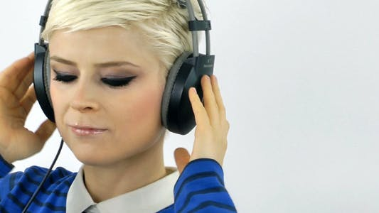 Thumbnail for Woman Listening Music