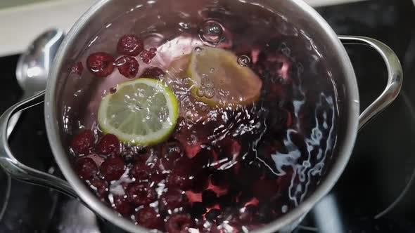 Thumbnail for Add Slice of Lemon in Pan with Water and Berries. Red, Black Currant, Raspberry