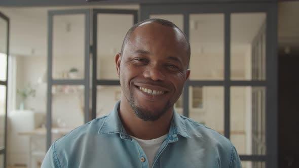 Friendly Handsome Black Man Smiling Indoors
