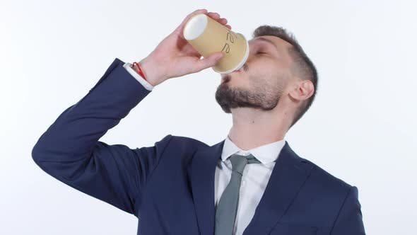 Thumbnail for Sleep-Deprived Businessman Drinking from Two Cups of Coffee