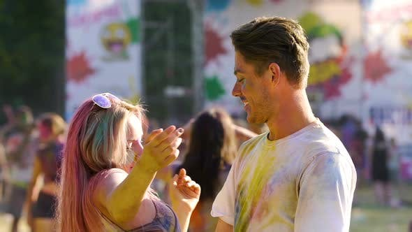 Thumbnail for Young Attractive Couple Dancing in a Colorful Dust at Traditional Holi Fest
