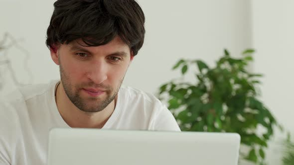 Businessman Using Laptop in Office Chatting in Social Network or Shopping Online Playing Game