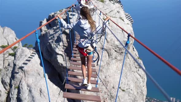 Thumbnail for Girls Crossing the Chasm on the Rope Bridge. Black Sea Background, Crimea