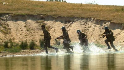 War soldiers running through the water, Ultra Slow Motion