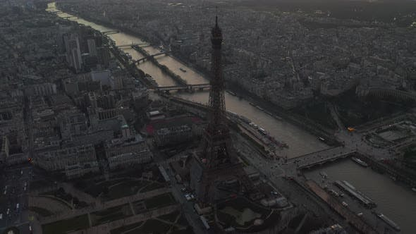 Thumbnail for AERIAL: Drone Slowly Circling Eiffel Tower, Tour Eiffel in Paris, France with View on Seine River in