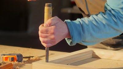 Carpenter carving wood