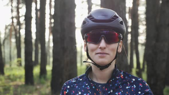 Portrait of female cyclist before ride on bicycle