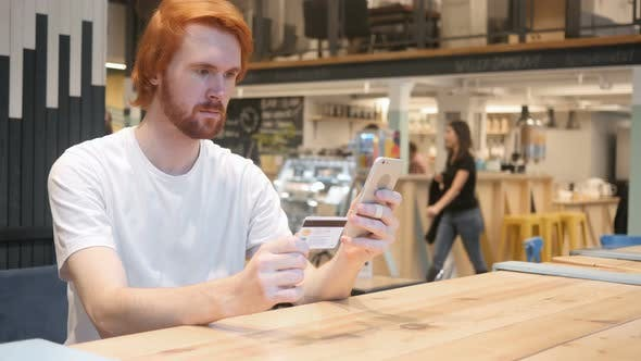 Thumbnail for Redhead Man in Cafe Shopping Online on Smartphone, Payment