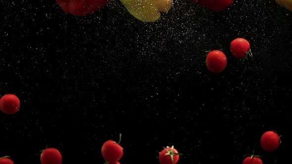 Cover Image for Fresh Vegetables Cherry Tomatoes and Red Yellow Paprika Bell Peppers Falling Into Water Black