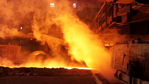 Hot Shop With Flowing Molten Steel In The Chute