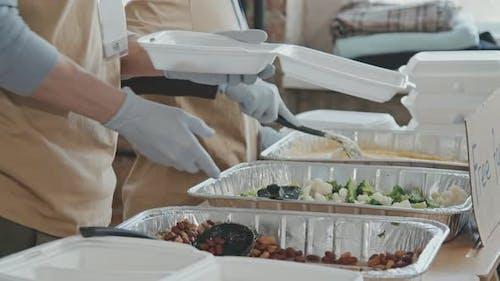 Volunteers Giving Food to People