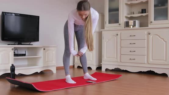 Thumbnail for Beautiful Confident Fitness Girl in an Athletic Workout Clothes is Doing Stretching