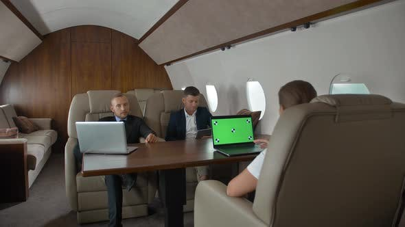 Businesspeople Have Meeting in Corporate Jet