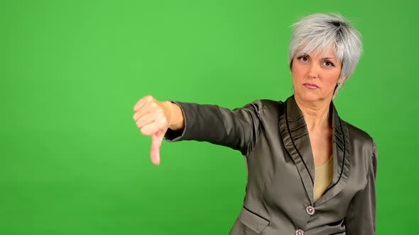 Thumbnail for Business Middle Aged Woman Shows Thumb on Disagreement - Green Screen - Studio