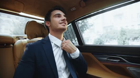 Relaxed Male Ceo Sitting in Comfortable Car Afterwork