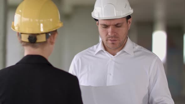 Thumbnail for Business People Man and Woman Discussing About Building Plan for Construction at Job Site