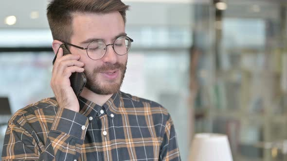 Thumbnail for Portrait of Cheerful Young Designer Talking on Smartphone