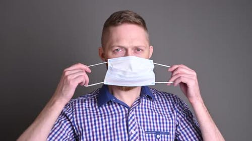 A man wears a medical mask to protect against covid-19. epidemic and viruses