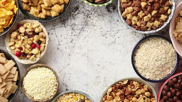 Thumbnail for Assortment of Different Kinds Cereals Placed in Ceramic Bowls on Table