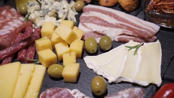 Restaurant Meat Platter (Ham, Salami, Bacon) on the Black Stone Tray
