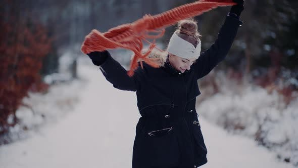 Thumbnail for Woman Wearing Scarf on Neck in Winter Outdoors