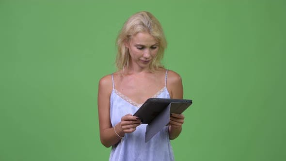 Young Happy Beautiful Businesswoman Thinking While Using Digital Tablet