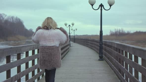 Thumbnail for Young Girl Walks Along the Promenade