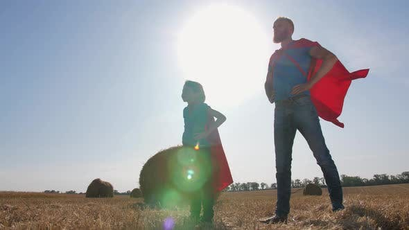Thumbnail for Playful Dad and Son Dressed As Supermen Outdoor