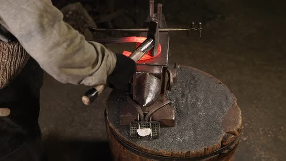 Thumbnail for Smith Bending Metal with a Hammer and a Anvil