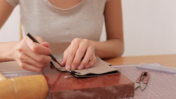 Thumbnail for Woman making leather craft at home