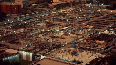 Time lapse of construction site with heavy construction machinery in metropolis
