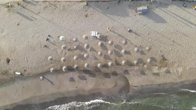 Umbrellas in Empty Sand Beach
