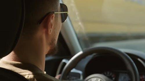 Man Driving Car And Talking