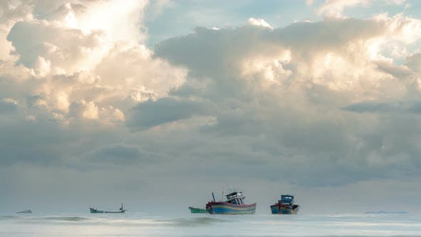Thumbnail for Coastal Fishing Boats moored at the Seaside on the Sunset with Storm Clouds