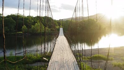 Suspension Bridge on Steel Ropes Over the River