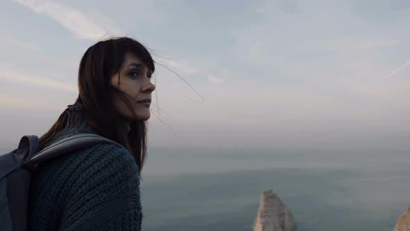 Thumbnail for Beautiful Thoghtful Tourist Woman Looking at Gorgeous Sunset Panorama Over Etretat Seaside Cliffs