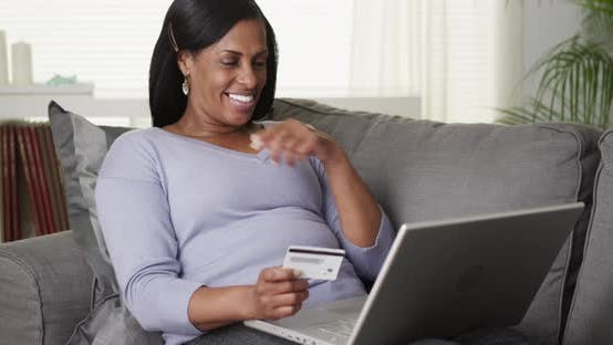 Thumbnail for Excited senior black woman buying online on laptop computer