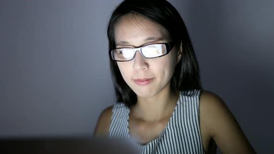 Thumbnail for Woman using digital tablet computer at home