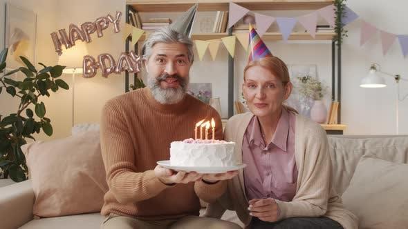 Thumbnail for Senior Couple With Birthday Cake
