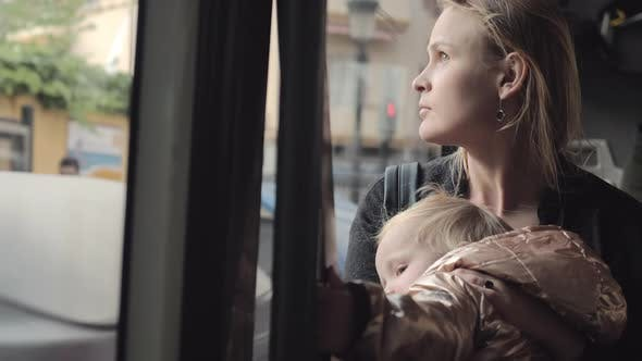 A young mother in a bus