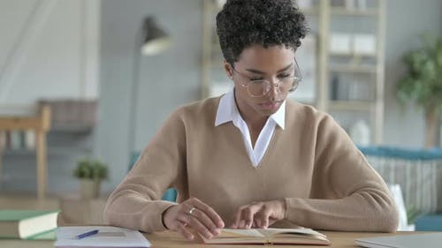 Ambitious African Girl Reading Her Note Book