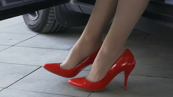 Thumbnail for Fancy Woman in Luxury Red Shoes Nervously Waiting for Her Man, Sitting in Car